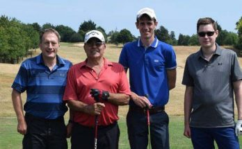 Team of four golfers